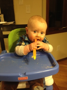 Trying to feed himself with a spoon. Needs practice...