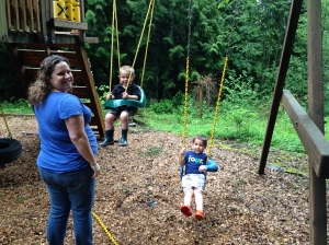 Brooke and her boys swinging on the swingset.
